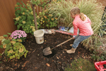 Step 1 - Dig soil to bury bucket
